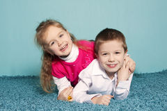 Brother and sister portrait. Portrait of brother and sister in the studio Royalty Free Stock Image