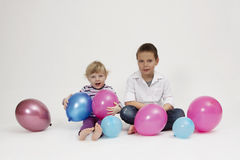 Brother and sister portrait with balloons. Brother and sister studio  portrait with balloons Stock Photography
