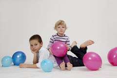 Brother and sister portrait with balloons. Brother and sister studio  portrait with balloons Stock Images