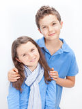 Brother and Sister. Portrait of a Brother and Sister, both wearing a blue shirt Royalty Free Stock Image