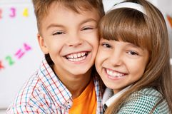 Brother and sister. Portrait of happy caucasian brother and sister, hugging Royalty Free Stock Images