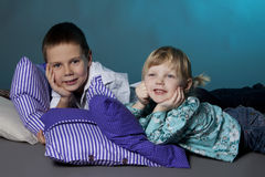 Brother and sister portrait with pillows Stock Image