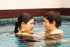 Brother and sister portrait in the swimming pool Stock Photography