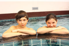 Brother and sister portrait in the swimming pool Stock Images