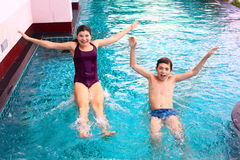 Brother and sister portrait in the swimming pool Royalty Free Stock Image