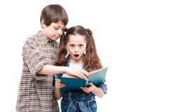 Brother and sister posing with a book Royalty Free Stock Image
