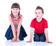Brother and sister posing in the studio Royalty Free Stock Image