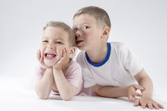 Brother and Sister Posing Together. Against White Background. Having Fun. Horizontal Image Stock Image