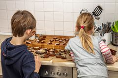 Brother and sister preparing cookies in the kitchen royalty free stock photo