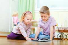Brother and sister reading Royalty Free Stock Photography