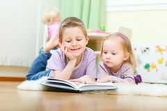 Brother and sister reading Royalty Free Stock Image