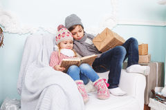 Brother and sister reading a book Stock Image