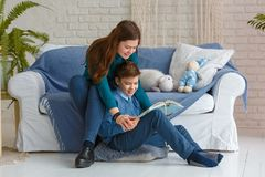 Brother and sister are reading a book. Photo session - friendly family. Brother and sister are reading a book royalty free stock photo