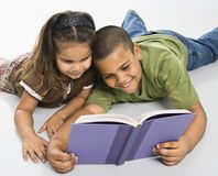Brother and sister reading book together. Royalty Free Stock Images