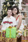 Brother and sister ready to open gifts Stock Photography