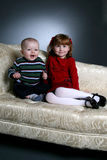 Brother and sister in red and green Royalty Free Stock Image