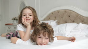 Brother And Sister Relaxing Together in the Bed. Cute Children are Having Fun in the Bedroom in the Morning. Brother And Sister Relaxing Together in the Bed stock video