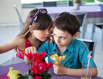 Brother and sister in a restaurant Stock Image