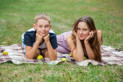 Brother and sister resting in the garden. Stock Images