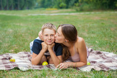 Brother and sister resting in the garden. Royalty Free Stock Images