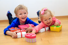 Brother and sister rivalry, sorting presents Royalty Free Stock Photos