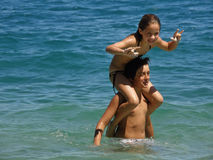 Brother and sister on sea. Brother keep sister on his shoulder -piggy back(spending holidays) at Adriatic sea (Croatia-Dalmatia Royalty Free Stock Image