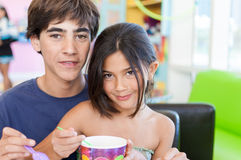 Brother and Sister share frozen yogurt Royalty Free Stock Image