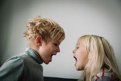 Brother and sister shout, concept of rivalry, dispute, anger, disagreement. Brother and sister shout, concept of kids rivalry, dispute, anger, disagreement stock image