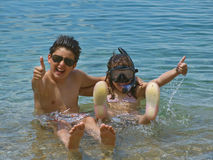 Children thumbs up at sea Royalty Free Stock Photos