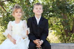 Brother and sister sit and smile royalty free stock photos