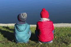 Childhood, Family, Travel Concept. Children Outdoors. Brother And Sister Sitting Near Water. Childhood, Family, Travel Concept. Children Outdoors royalty free stock images