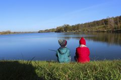 Childhood, Family, Travel Concept. Children Outdoors. Brother And Sister Sitting Near Water. Childhood, Family, Travel Concept. Children Outdoors stock images