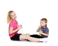 Brother and sister sitting Stock Photography
