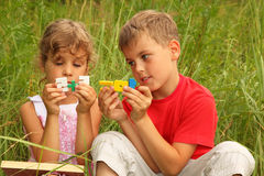 Brother and sister sitting and play Stock Photography