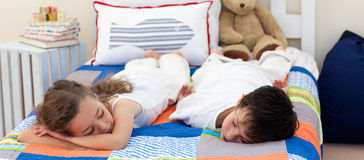 Brother and sister sleeping. Cute Brother and sister sleeping on bed Royalty Free Stock Photo