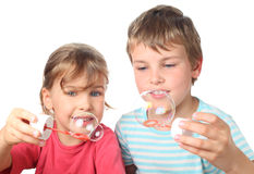 Brother and sister smiling and blowing bubbles Royalty Free Stock Photo