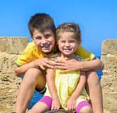 Brother and sister smiling under the sun Stock Images