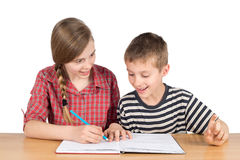 Brother and Sister Solving Math Problems Together Isolated on White. Brother and Sister Solving Math Problems Together, Half-Length Studio Shot Isolated on White Royalty Free Stock Images