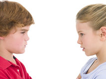 Brother and sister staring. At each other Stock Photos