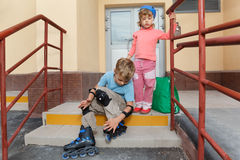 Brother and sister on steps of house. Royalty Free Stock Photography