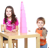Brother and sister stroyut Red Pyramid, Montessori Stock Photo