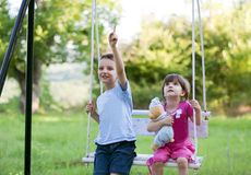 Brother and sister on a swing Royalty Free Stock Photography