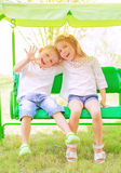 Brother and sister on the swing Stock Photo