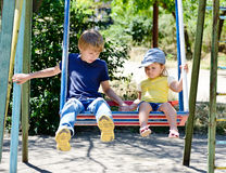 Brother and sister on the swing Stock Images