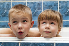 Brother and sister taking a bubble bath. Little boy and girl pla Stock Photography