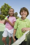 Brother and Sister at Tennis Net portrait Stock Photography