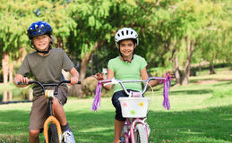 Brother and  sister with their bikes Stock Photos