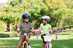 Brother and  sister with their bikes Royalty Free Stock Image