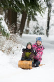 Brother and sister tobogganing Royalty Free Stock Images