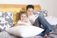 Brother And Sister together In Bed Stock Photography